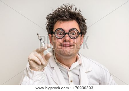 Crazy Doctor Performing Experiments In Hospital