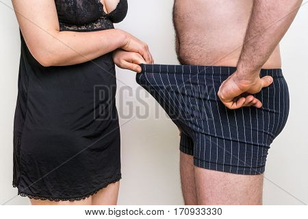 Man And Woman Looking Down Into Underwear