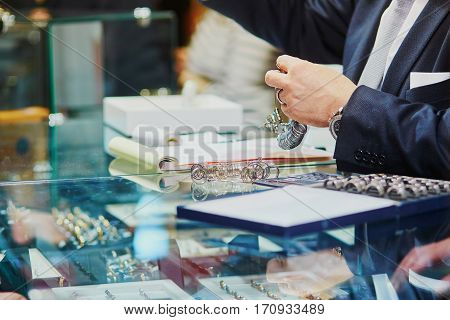 Jeweller With Many Wedding Ring Samples