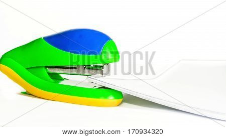 Bright stapler and paper pack on a white background