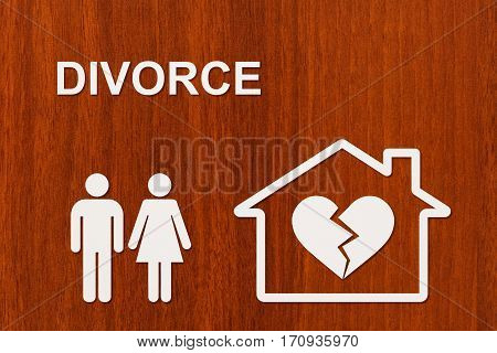 Paper family and house with broken heart and text DIVORCE. Abstract conceptual image