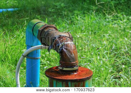 plumbing main tube and water leak old tap pipe steel rust on grass floor