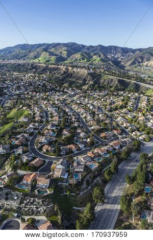 Aerial view of Porter Ranch homes and streets in the San Fernando Valley area of Los Angeles, California.