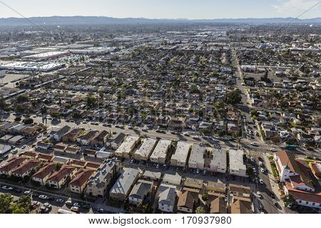 Aerial view of hazy sprawling San Fernando Valley communities in Los Angeles, California.