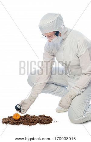 Chemical Ecologist Measures The Level Of Radiation In The Soil On The White Background