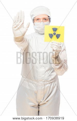 Woman In The Affected Area With Radiation In A Protective Suit With A Sign Of Radiation