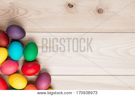 A Bunch Of Easter Eggs In The Corner And A Wooden Background For An Inscription