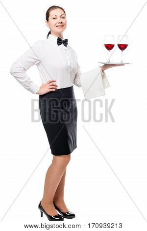 Woman Employee Of The Restaurant With Wine Glasses On A Tray To Its Full Length Isolated