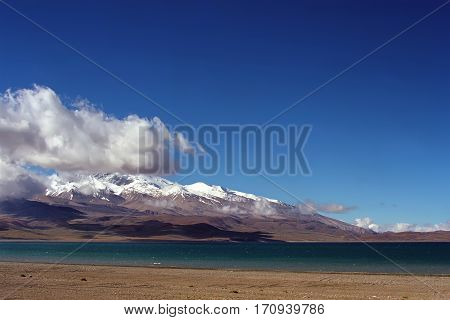 On the shore of sacred Rakshastal lake (4541 m) near Gurla-Mandhata Mount (7694 m) in Western Tibet.