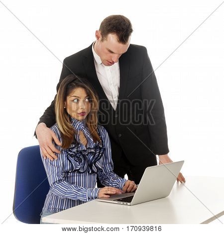 secretary with laptop at table seems afraid of boss who makes advances in studio against white background