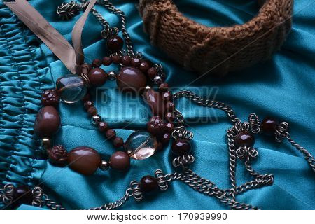 beautiful women's jewelry with stones on a contrasting background
