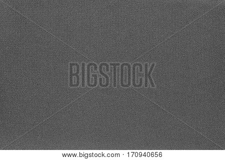 abstract speckled texture and background of textile material or fabric of dark gray color