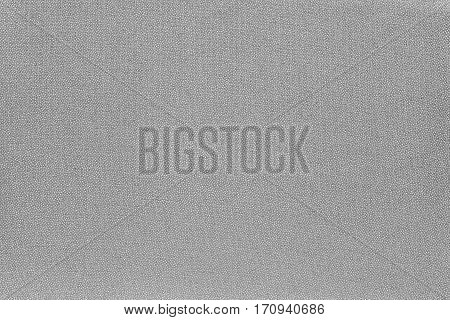abstract speckled texture and background of textile material or fabric of pale gray color