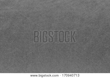 abstract background and speckled or mottled texture of fabric or textile material of gray color