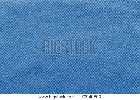abstract background and texture of denim fabric or textile material of pale blue color
