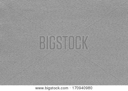 background and abstract grained texture of textile material or fabric of pale gray color
