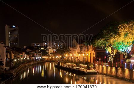 MELAKA MALAYSIA - 2014 June 15: World Heritage with the canal and the city night