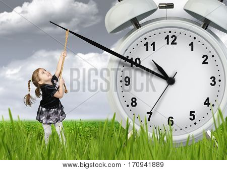 Little child girl pulling hand clock time stop concept