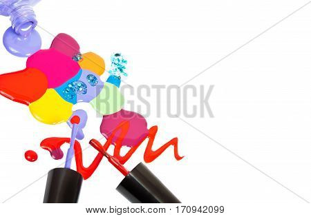 Brush of nail polish and colored drops isolated on white background.