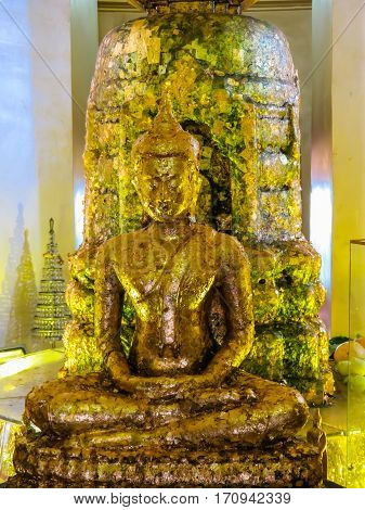 BANGKOK, THAILAND - JANUARY 17, 2014: Golden statue of the sitting Buddha in the Wat Saket Temple. Buddhist Temple Wat Saket or Golden mount Bangkok Thailand. Selective focus