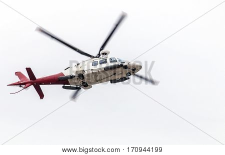 Airborn Helicopter Isolated Against White Overcast Sky