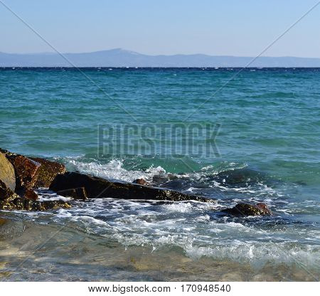 Sea wave and stones. Kassandra Halkidiki Greece