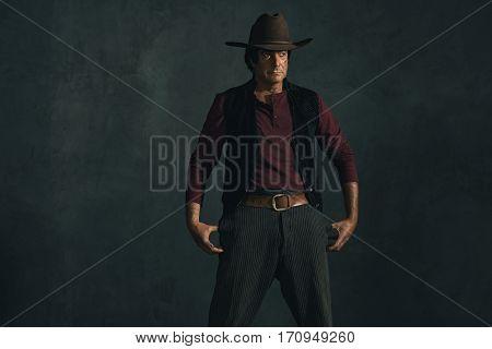 Retro late 1960s spaghetti western actor. Studio shot.