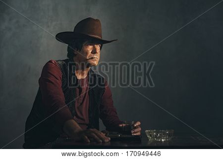 Retro Late 1960S Mexican Western Actor Smoking Cigarette At Bar.