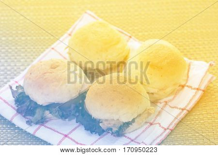 Close up of mini burgers on the table