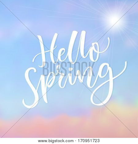 Hello Spring. Inspirational saying at blue sky background with cloud. Spring season greeting