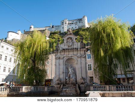 SALZBURG, AUSTRIA - APRIL 29, 2016: View of the old Horse Well at the Kapitelplatz Square in Salzburg Austria.