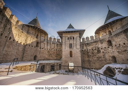 beautiful old medieval fortress winter landscape and blue sky