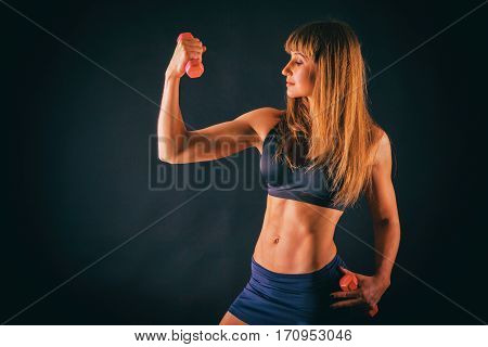 Sexual sports girl on a dark background.