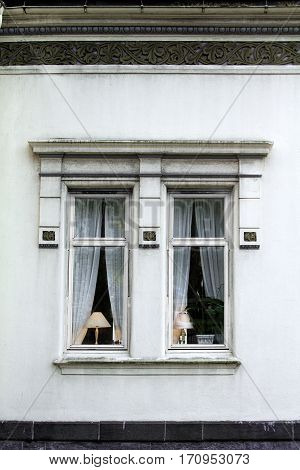 lampshade lit window exterior white house home