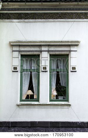 lampshade lit window exterior green home house