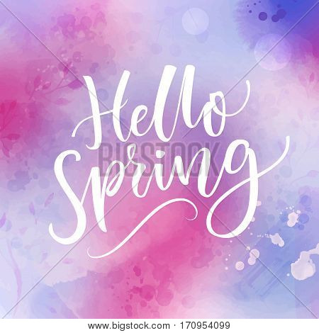 Hello spring banner with calligraphy at violet and pink watercolor background. March greetings. Inspirational saying.