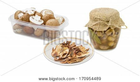 Dried boletus pickled button mushrooms in glass jar fresh uncooked button mushrooms in a transparent plastic tray on a light background