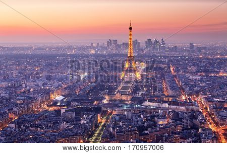 PARIS - FEBRUARY 7: Eiffel Tower brightly illuminated at dusk on FEBRUARY 7 2015 in Paris. The Eiffel tower is the most visited monument of France.