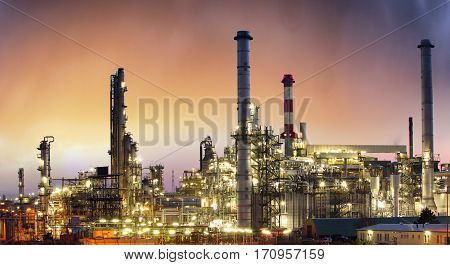 Industry Oil petrochemical plant at a sunset