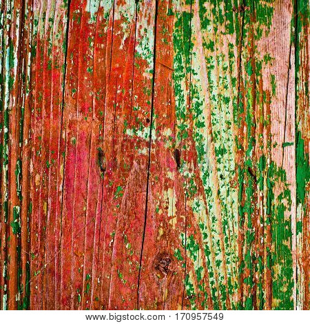 old painted wood texture closeup background in red and green