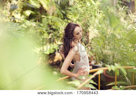 Sexy Woman In Lingerie In Tropical Enviroment