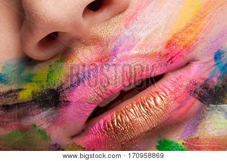 Vibrant colors on lips and mouth in close up photo. Studio photo. Beauty close up