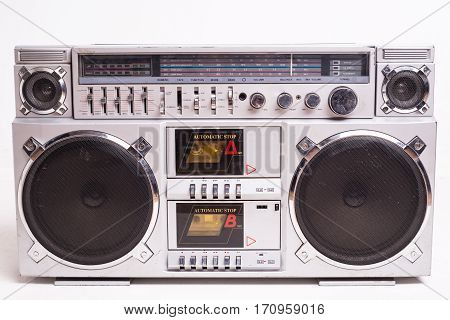 Front View of a Vintage Boom Box Cassette Tape Player Isolated on White Background.