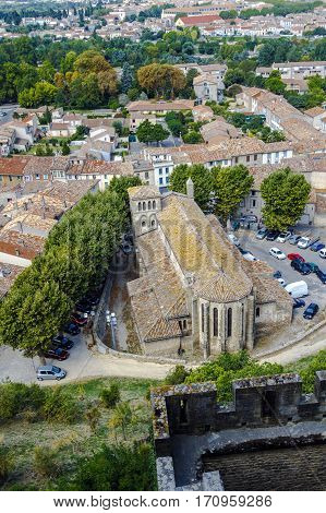 Carcassonne seen from the defensive walls of the castle in winter to the roofs. Church of Saint Gimer