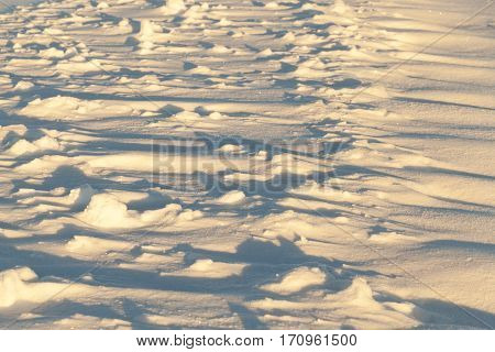 lying on the ground of snow drifts after a blizzard. Photo close-up in winter.
