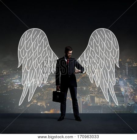 Business angel standing over night city background.  Business, sponsoring, investment, concept.