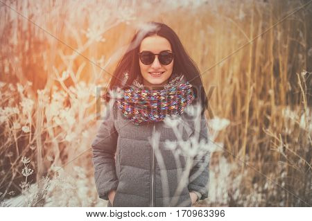 beautiful smiling girl wearing fashionable winter outdoors
