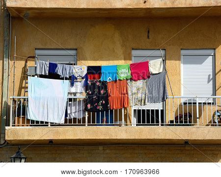 IERAPETRA, CRETE - SEPTEMBER 18, 2016 - Washing drying on an apartment balcony Ierapetra Crete Greece Europe, September 18, 2016.