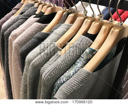 Cardigan on a clothes rack for winter closing