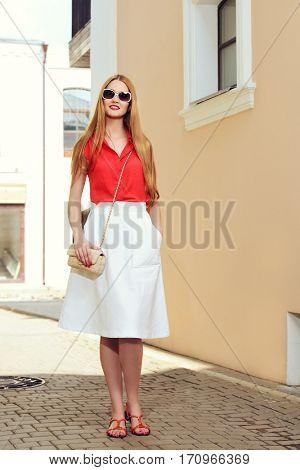 Beautiful young woman walking in the city. Beauty, fashion. Businesswoman outdoor.